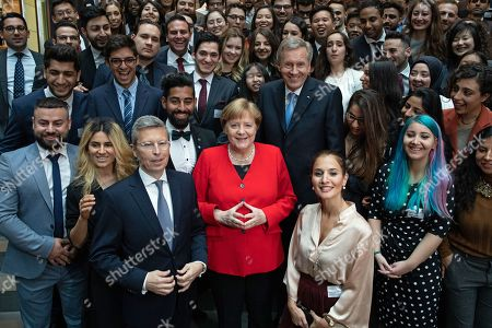 German Chancellor Angela Merkel (C), former German president Christian Wulff (C-R), strategic consultant Thomas Gauly (front L) and other unidentified particiupants pose for a familiy photo among selected fellows of the German Integration Foundation during an event marking the 70th anniversary of the German Basic Law ( Grundgesetz) in Berlin, Germany, 14 May 2019.  The German Basic Law was approved on 08 May 1949 in the Federal Republic of Germany and came into effect on 23 May 1949. It is the German constitution.