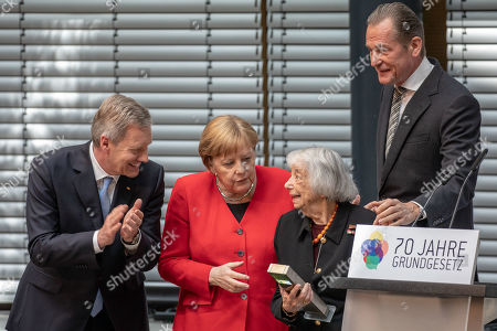Former German president and chair of the Germany Foundation Integration Christian Wulff (L), German Chancellor Angela Merkel (2-L), and Axel Springer publishing house CEO Matthias Doepfner (R) award the foundation's Talisman prize to Holocaust Survivor Margot Friedlaender (2-R) during an event marking the 70th anniversary of the German Basic Law ( Grundgesetz) in Berlin, Germany, 14 May 2019. The German Basic Law was approved on 08 May 1949 in the Federal Republic of Germany and came into effect on 23 May 1949. It is the German constitution.
