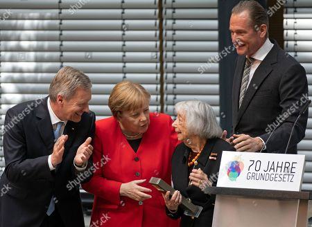 Stock Image of Former German president and chair of the Germany Foundation Integration Christian Wulff (L), German Chancellor Angela Merkel (2-L), and Axel Springer publishing house CEO Matthias Doepfner (R) award the foundation's Talisman prize to Holocaust Survivor Margot Friedlaender (2-R) during an event marking the 70th anniversary of the German Basic Law ( Grundgesetz) in Berlin, Germany, 14 May 2019. The German Basic Law was approved on 08 May 1949 in the Federal Republic of Germany and came into effect on 23 May 1949. It is the German constitution.