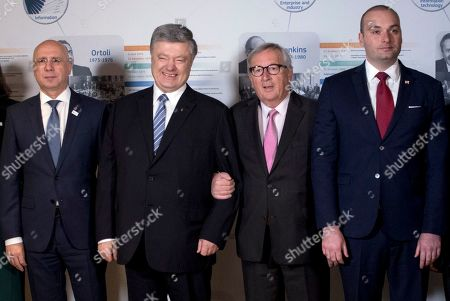 From left, Moldova's Prime Minister Pavel Filip, Ukrainian President Petro Poroshenko, European Commission President Jean-Claude Juncker and Georgian Prime Minister Mamuka Bakhtadze pose for a group photo during a conference, Eastern Partnership,Ten Years, at the EU Charlemagne building in Brussels