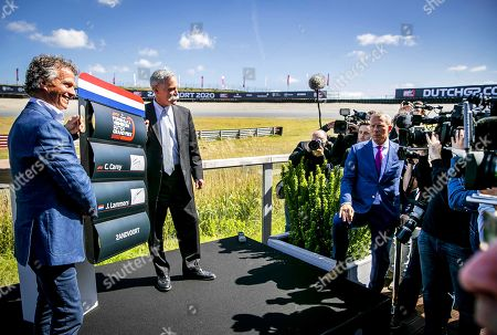 Dutch Grand Prix sporting director Jan Lammers (L) and Formula One Group CEO Chase Carey (2-L) pose for photographers at the Circuit Zandvoort, Netherlands, 14 May 2019. The Dutch Formula One Grand Prix will return to Zandvoort in May 2020 for the first time since 1985.