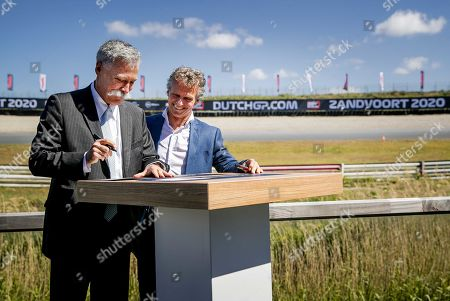 Formula One Group CEO Chase Carey (L) and Dutch Grand Prix sporting director Jan Lammers (R) sign an agreement at the Circuit Zandvoort, Netherlands, 14 May 2019. The Dutch Formula One Grand Prix will return to Zandvoort in May 2020 for the first time since 1985.