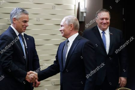 Mike Pompeo, Vladimir Putin. Russian President Vladimir Putin, shakes hands with U.S. Ambassador to Russia Jon Huntsman, left, as U.S. Secretary of State Mike Pompeo, stands behind prior to their talks in the Black Sea resort city of Sochi, southern Russia, . Pompeo arrived in Russia for talks that are expected to focus on an array of issues including arms control and Iran
