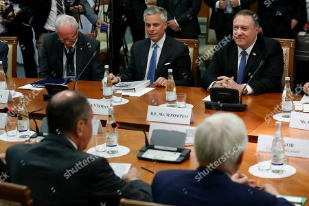 Stock Image of Mike Pompeo, Sergey Lavrov. U.S. Secretary of State Mike Pompeo, right, and U.S. Ambassador to Russia Jon Huntsman, second left, listen to Russian Foreign Minister Sergey Lavrov, left, back to a camera, during their talks in the Black Sea resort city of Sochi, southern Russia, . Pompeo's first trip to Russia starts Tuesday in Sochi, where he and Russian Foreign Minister Sergey Lavrov are sitting down for talks and then having a joint meeting with President Vladimir Putin