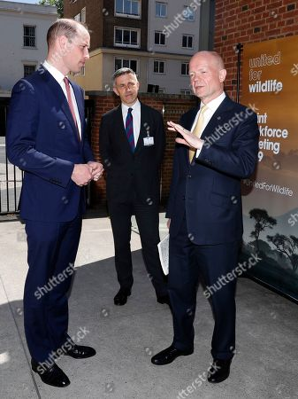 Britain's Prince William, left, speaks to William Hague upon arriving at a joint meeting of the United for Wildlife task forces for the financial and transport sector to combat illegal wildlife trade at the Royal Geographical Society in London, . The meeting will be the first time the two groups have come together and will explore what more the 120 members can do to work together to combat illegal wildlife trade