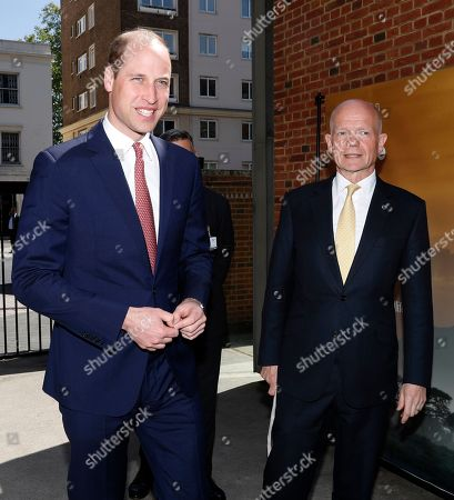 Prince William, left, speaks to William Hague upon arriving at a joint meeting of the United for Wildlife task forces for the financial and transport sector to combat illegal wildlife trade