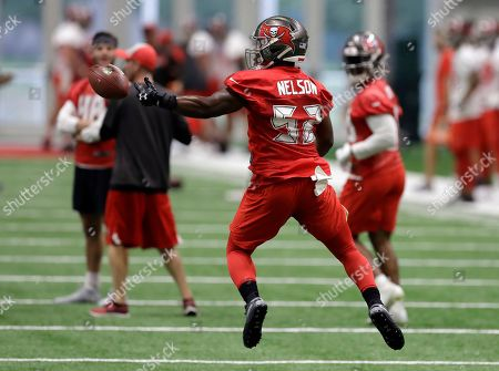 Tampa Bay Buccaneers linebacker Corey Nelson can't hang onto the ball during practice at the NFL football team's training facility, in Tampa, Fla