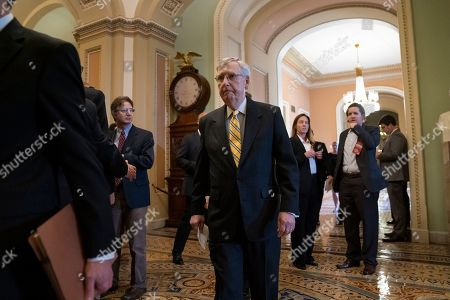 Senate Majority Leader Mitch McConnell, R-Ky., walks to the chamber at the Capitol in Washington, . McConnell told his colleagues during the private GOP luncheon that he trusted Senate Intelligence Committee Chairman Richard Burr, R-N.C., on the decision to subpoena Donald Trump Jr. who had backed out of two scheduled interviews as part of the panel's Russia investigation