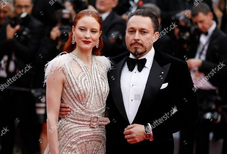 Barbara Meier, Klemens Hallmann. Model Barbara Meier, left, and Klemens Hallmann pose for photographers upon arrival at the opening ceremony and the premiere of the film 'The Dead Don't Die' at the 72nd international film festival, Cannes, southern France
