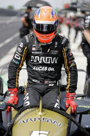 James Hinchcliffe, of Canada, climbs into his car during practice for the Indianapolis 500 IndyCar auto race at Indianapolis Motor Speedway, in Indianapolis