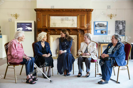 Britain's Kate, the Duchess of Cambridge, centre talks with Bletchley veterans from left, Elizabeth Diacon, Georgina Rose, Audrey Mather and Rena Stewart during a visit to Bletchley Park to view a special D- Day exhibition in the newly restored Teleprinter Building, marking the 75th anniversary of the D-Day landings, in Milton Keynes, England