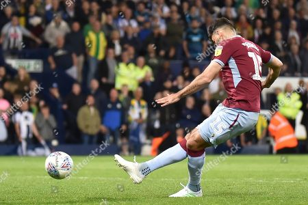 Aston Villa midfielder Mile Jedinak (15) scores a goal from the penalty spot during the EFL Sky Bet Championship play-off second leg match between West Bromwich Albion and Aston Villa at The Hawthorns, West Bromwich