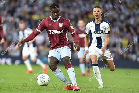 Aston Villa defender (on loan from Manchester United) Axel Tuanzebe (4) shields the ball from West Bromwich Albion defender Kieran Gibbs (3)during the EFL Sky Bet Championship play-off second leg match between West Bromwich Albion and Aston Villa at The Hawthorns, West Bromwich