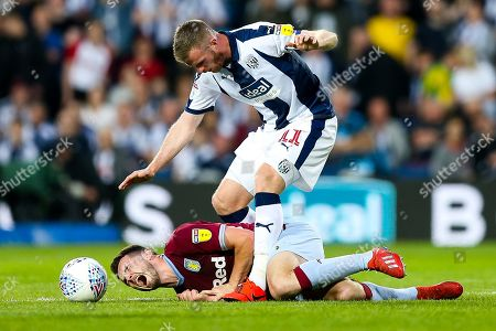 Stock Picture of John McGinn of Aston Villa is fouled by Chris Brunt of West Bromwich Albion