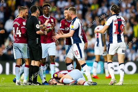 Jack Grealish of Aston Villa pleads with the referee after Chris Brunt of West Bromwich Albion fouls John McGinn of Aston Villa