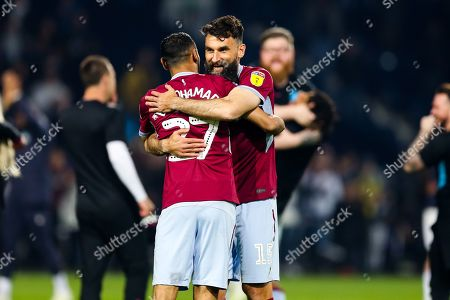 Mile Jedinak and Ahmed Elmohamady of Aston Villa hug as the players celebrate after Aston Villa win the game on penalties to reach the Sky Bet Championship Final at Wembley