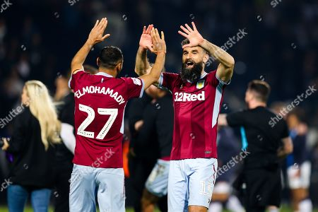 Mile Jedinak and Ahmed Elmohamady of Aston Villa high five as the players celebrate after Aston Villa win the game on penalties to reach the Sky Bet Championship Final at Wembley