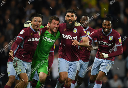 Jack Grealish of Aston Villa celebrates with team-mates Goal keeper Jed Steer of Aston Villa and Mile Jedinak of Aston Villa after the penalty shoot-out