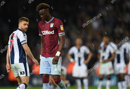 James Morrison of West Bromwich Albion looks back towards a nervous Tammy Abraham of Aston Villa before his penalty