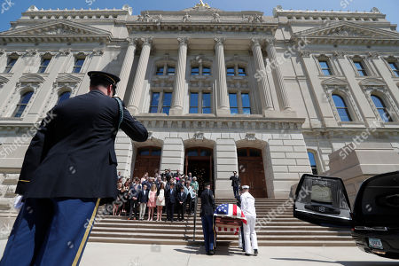 A military honor guard carries the casket of Sen. Richard Lugar into the Indiana Statehouse in Indianapolis, . Lugar will lay in repose in the Statehouse rotunda until noon Wednesday, followed by his funeral. He died April 28 at age 87