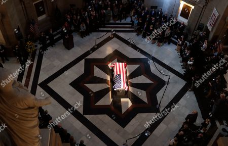 """The casket of Sen. Richard Lugar is illuminated in the Indiana Statehouse rotunda in Indianapolis, . Lugar was a longtime Republican senator and former Indianapolis mayor who's been hailed as an """"American statesman"""" since he died April 28 at age 87"""