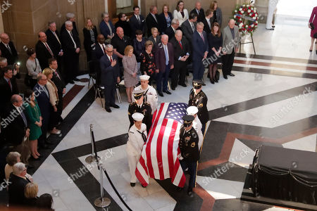 """A military honor guard escorts the casket of Sen. Richard Lugar into the Indiana Statehouse in Indianapolis, . Lugar was a longtime Republican senator and former Indianapolis mayor who's been hailed as an """"American statesman"""" since he died April 28 at age 87"""