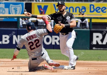 Chicago White Sox second baseman Yolmer Sanchez (5) to first base to complete a double play after forcing out Cleveland Indians' Jason Kipnis (22) at second base during the first inning of a baseball game, in Chicago