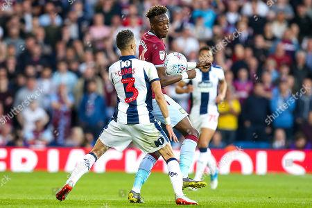 Tammy Abraham of Aston Villa takes on Kieran Gibbs of West Bromwich Albion