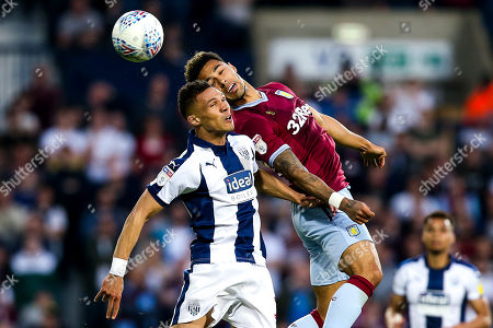 Andre Green of Aston Villa challenges Kieran Gibbs of West Bromwich Albion