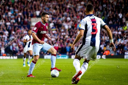 John McGinn of Aston Villa takes on Kieran Gibbs of West Bromwich Albion