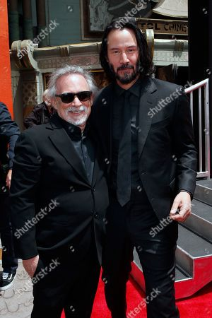 Manager Erwin Stoff and Canadian actor Keanu Reeves during a hand print ceremony where Reeves is honored at the TCL Chinese Theatre IMAX in Hollywood, Los Angeles, California, USA, 14 May 2019. Reeves new movie John Wick 3 opens in the US 17 May 2019.