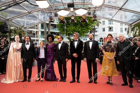Elle Fanning, Alejandro Gonzalez Inarritu, Kelly Reichardt, Maimouna N'Diaye, Enki Bilal, Pawel Pawlikowski, Yorgos Lanthimos, Alice Rohrwacher, Robin Campillo. Jury member Elle Fanning, jury president Alejandro Gonzalez Inarritu, jury members Kelly Reichardt, Maimouna N'Diaye, Enki Bilal, Pawel Pawlikowski, Yorgos Lanthimos, Alice Rohrwacher, and Robin Campillo pose for photographers upon arrival at the opening ceremony and the premiere of the film 'The Dead Don't Die' at the 72nd international film festival, Cannes, southern France