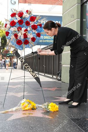 Ana Martinez of the Hollywood Chamber of Commerce leaves flowers and a note on the Walk of Fame star for US actor Tim Conway in Hollywood, California, USA, 14 May 2019. Conway died at the age of 85, he was well known for his sketch comedy program in The Carol Burnett Show.