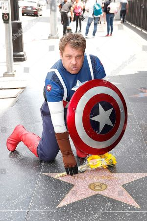 Stock Picture of Justin Harrison dressed as Captain America leaves flowers on the Walk of Fame star for US actor Tim Conway in Hollywood, California, USA, 14 May 2019. Conway died at the age of 85, he was well known for his sketch comedy program in The Carol Burnett Show.