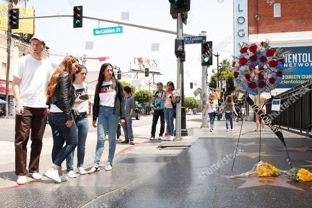 Stock Photo of Fans stop for a moment on the Walk of Fame star for US actor Tim Conway in Hollywood, California, USA, 14 May 2019. Conway died at the age of 85, he was well known for his sketch comedy program in The Carol Burnett Show.