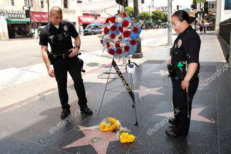 Stock Picture of Two LAPD officers stop for a moment on the Walk of Fame star for US actor Tim Conway in Hollywood, California, USA, 14 May 2019. Conway died at the age of 85, he was well known for his sketch comedy program in The Carol Burnett Show.