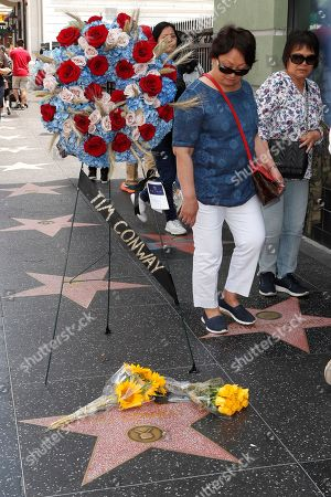 Fans stop for a moment on the Walk of Fame star for US actor Tim Conway in Hollywood, California, USA, 14 May 2019. Conway died at the age of 85, he was well known for his sketch comedy program in The Carol Burnett Show.