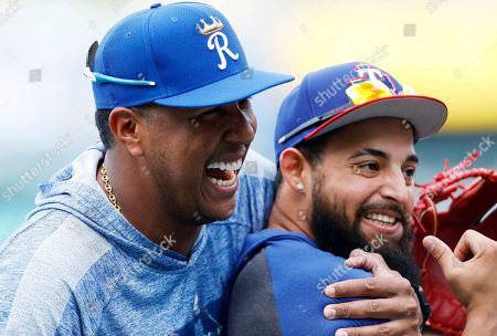 Salvador Perez, Rougned Odor. Kansas City Royals catcher Salvador Perez, left, hugs Texas Rangers' Rougned Odor, right, as they visit during batting practice before a baseball game at Kauffman Stadium in Kansas City, Mo., . The six-time All-Star catcher is not playing this season after undergoing Tommy John surgery in March to repair ligament damage to his right elbow