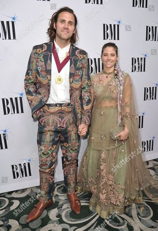 Jason Evigan, Victoria Evigan. Jason Evigan, left, and Victoria Evigan arrive at the 67th annual BMI Pop Awards, at the Beverly Wilshire Hotel in Beverly Hills, Calif
