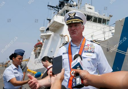 Captain John Driscoll, commanding officer of the U.S. Coast Guard National Security Cutter Bertholf (WMSL 750), background, talks to the media as it arrives for a port call in the first visit by a U.S. cutter in over seven years, in Manila, Philippines. Driscoll told reporters that two Chinese Coast Guard ships were spotted off the South China Sea while they were conducting a joint exercise with Philippine Coast Guard