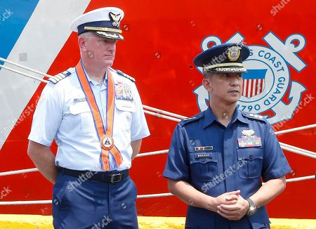 Stock Picture of Armand Balilo, John Driscoll. Captain John Driscoll, left, commanding officer of the U.S. Coast Guard National Security Cutter Bertholf (WMSL 750), and Philippine Coast Guard Spokesman Commander Armand Balilo, talk to the media during a port call by the U.S. cutter in Manila, Philippines. Capt. Driscoll told reporters that two Chinese Coast Guard ships were spotted off the South China Sea while they were conducting a joint exercise with Philippine Coast Guard