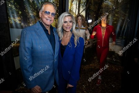 Lee Majors (L) and his wife US actress Faith Majors (R) pose next to a model of his character in the tv-show 'The Six Million Dollar Man' during the unveiling of the 'Batman' and 'The Six Million Dollar Man' exhibition at the Hollywood Museum in Los Angeles, USA, 14 May 2019. The Batman exhibition marks the 80th anniversary of the superhero.