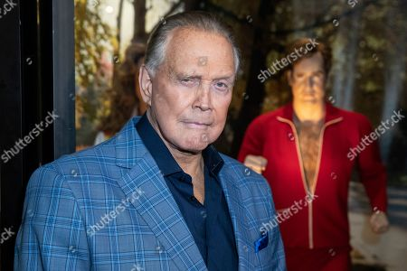 Lee Majors poses next to a model of his character from the tv-show 'The Six Million Dollar Man' during the unveiling of the 'Batman' and 'The Six Million Dollar Man' exhibition at the Hollywood Museum in Los Angeles, USA, 14 May 2019. The Batman exhibition marks the 80th anniversary of the superhero.