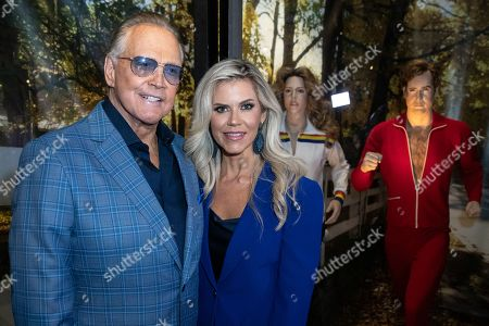 Lee Majors and his wife US actress Faith Majors pose next to a model of his character in the tv-show 'The Six Million Dollar Man' during the unveiling of the 'Batman' and 'The Six Million Dollar Man' exhibition at the Hollywood Museum in Los Angeles, USA, 14 May 2019. The Batman exhibition marks the 80th anniversary of the superhero.