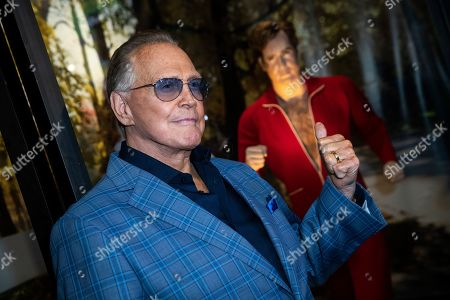 Stock Photo of Lee Majors poses next to a model of his character in the tv-show 'The Six Million Dollar Man' during the unveiling of the 'Batman' and 'The Six Million Dollar Man' exhibition at the Hollywood Museum in Los Angeles, USA, 14 May 2019. The Batman exhibition marks the 80th anniversary of the superhero.