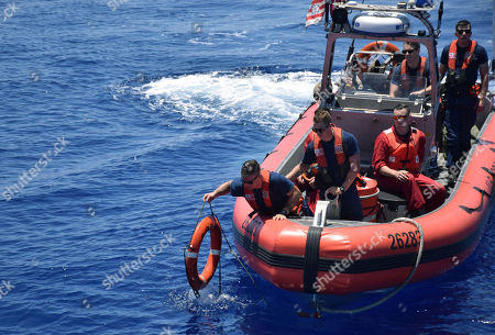 Provided by the Philippine Coast Guard, the American Coast Guard conducts joint search and rescue exercises with their Philippine counterparts off the South China Sea west of the Philippines. Captain John Driscoll, commanding officer of the U.S. Coast Guard National Security Cutter Bertholf (WMSL 750), told reporters Wednesday, May 15, 2019, two Chinese Coast Guard ships were spotted off the South China Sea while they were conducting the joint exercise with Philippine Coast Guard