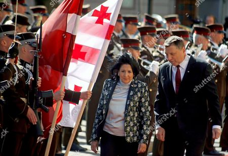 Georgian President Salome Zourabichvili (C) and Latvian President Raimonds Vejonis (R) inspect a guard of honor during a welcoming ceremony in Riga, Latvia, 15 May 2019. Georgian President Zourabichvili is on a one-day official visit to Latvia.