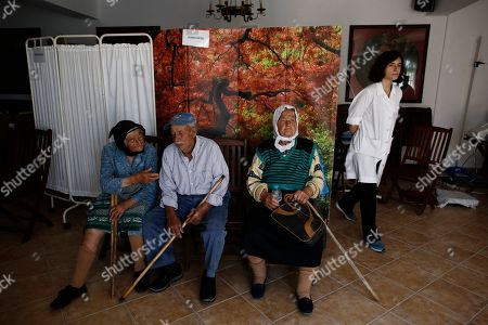 (01/21) Residents Stavros Prassinos (C), 84, Evdokia Sigala (R), 79 and Fani Prasinou (L), 87, wait to be examined by the members of the doctors team called 'Anagennissi and Proodos' (Renaissance and Progress), inside cultural center during their mission on the Greek island of Donoussa, in the Aegean Sea, to provide medical services to its few inhabitant, Donoussa, Greece, 03 May 2019. 'Anagennissi and Proodos' launched in 2008, and its primary purpose is to fill in the health care shortages faced by the inhabitants of the border regions of Greece, and in particular the 30 remote islands, without any discrimination.