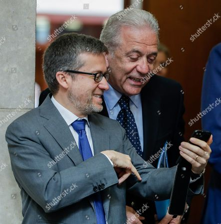 Commissioner responsible for Research, Science and Innovation, Portuguese, Carlos Moedas  (L) and Dimitrios Avramopoulos, European Commissioner for Migration, Home Affairs and Citizenship attend the weekly college meeting of the European Commission in Brussels, Belgium, 15 May 2019.