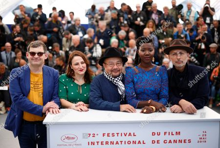 Jury Members: Nicolas Naegelen, French filmmaker Sandrine Marques, President of the Jury, Cambodian-French director Rithy Panh, French director Alice Diop and French cinematographer Benoit Delhomme poses during the Camera d'Or Jury photocall at the 72nd annual Cannes Film Festival, in Cannes, France, 15 May 2019. The festival runs from 14 to 25 May.
